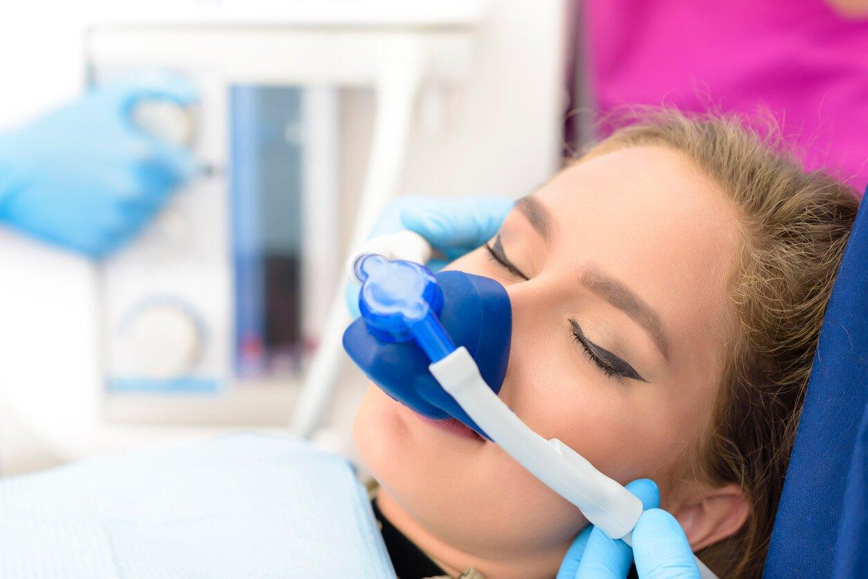 woman inhalation sedation at dental clinic